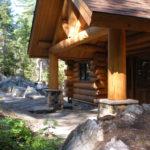 cedar log and stone entryway