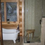 glass shower pebble floor