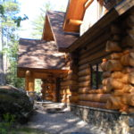 huge cedar logs, stone landscaping