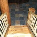 log stairway, railing, slate floor