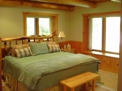 Basement bedroom cedar log beams