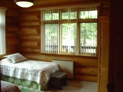 Bedroom hand scribed Western Cedar log home