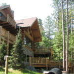Cedar log home decks log railing
