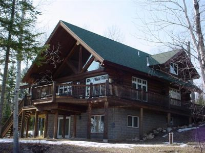 Dark stained cedar log home