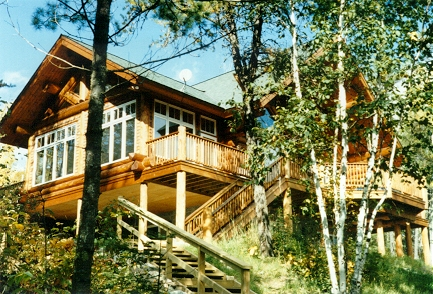 From stairs to lake, cedar log home deck railing