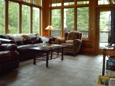 Living room hand scribed cedar log home