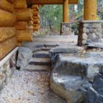 Log home stone landscaping