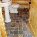 Slate floor, pine door cedar log walls
