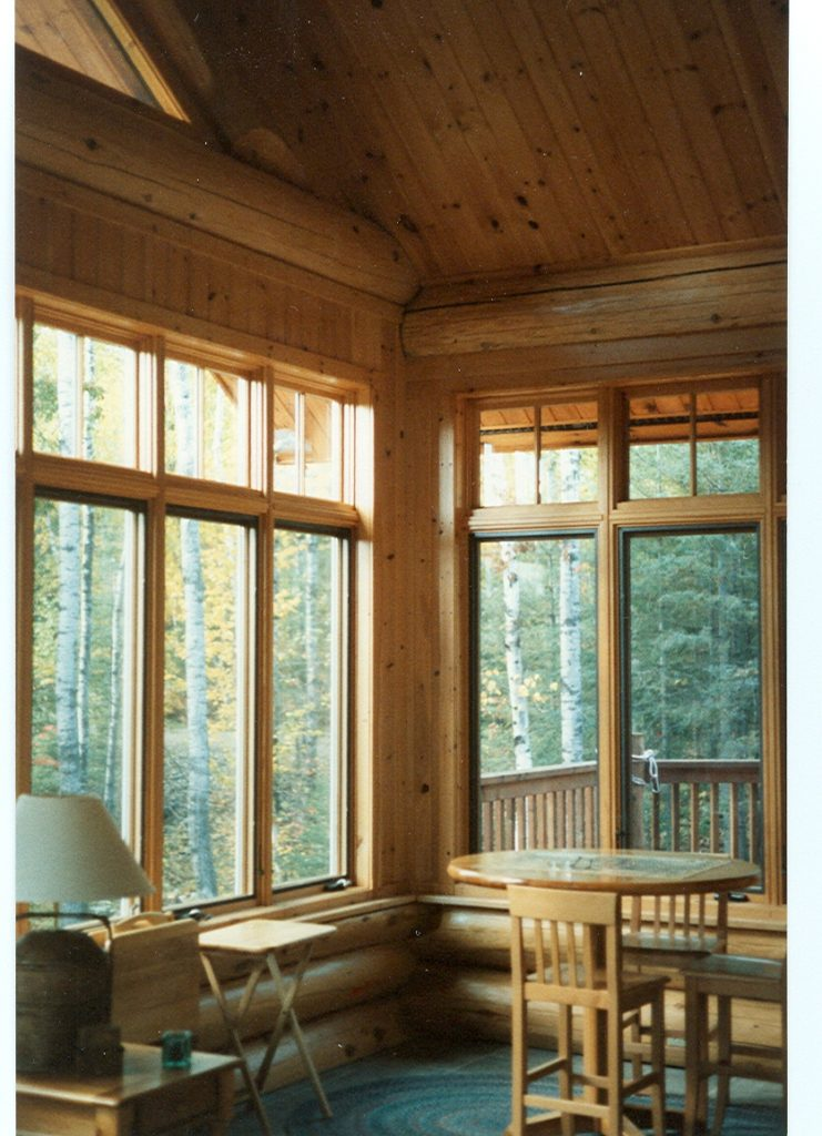 Sunroom in hand scribed cedar log house