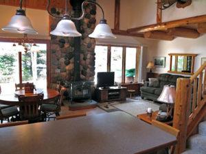 living room woodstove stone chimney