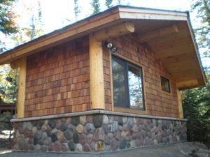 Stone and cedar Sauna building