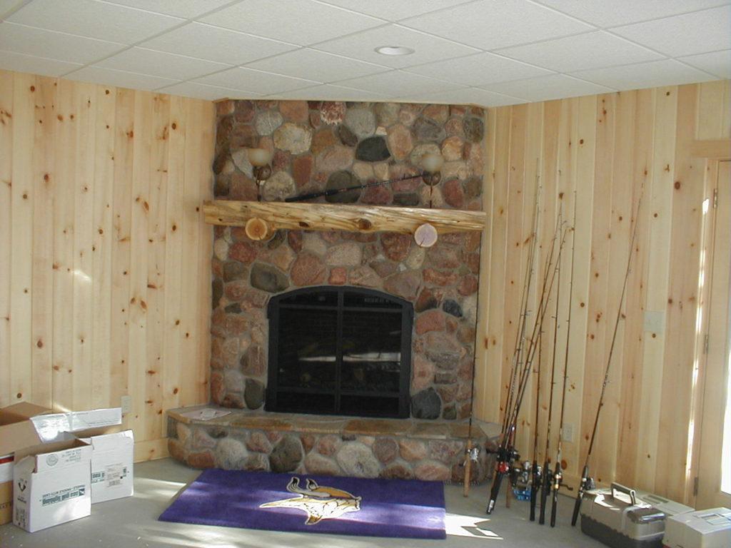 Basement stone fireplace