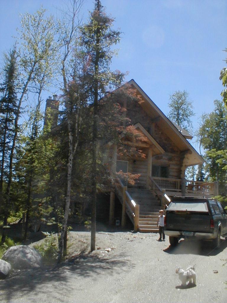 Cedar log home entry side