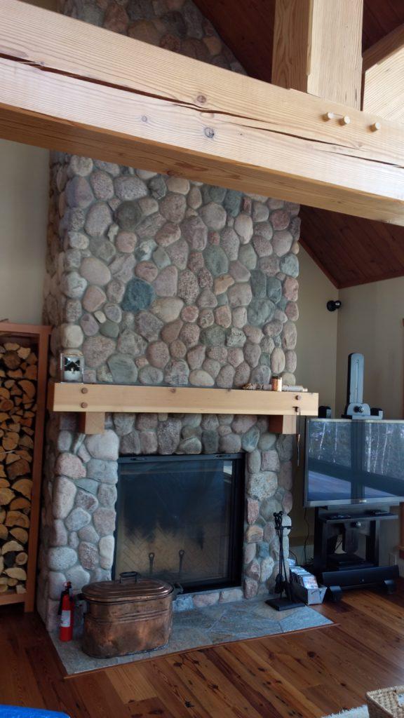 Stone fireplace fir timbers