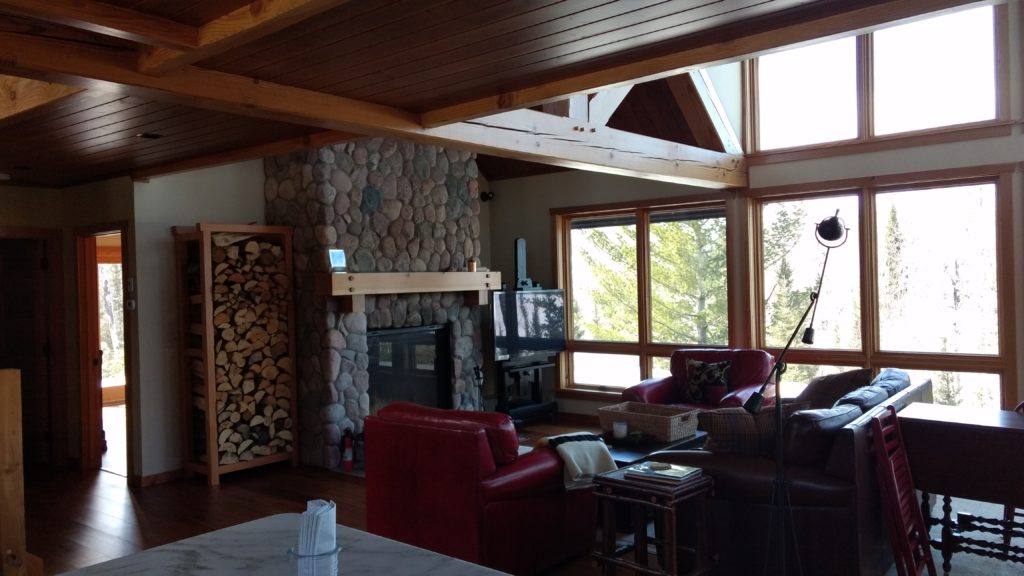 Stone fireplace, timber trusses