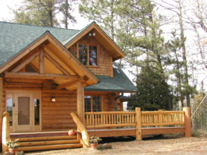 Cedar Logs and railing, dormers, main entry