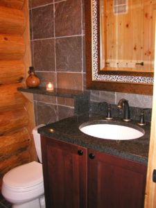Powder room, granite, tile and log
