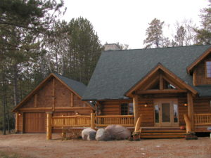 Cedar log home, entry and garage