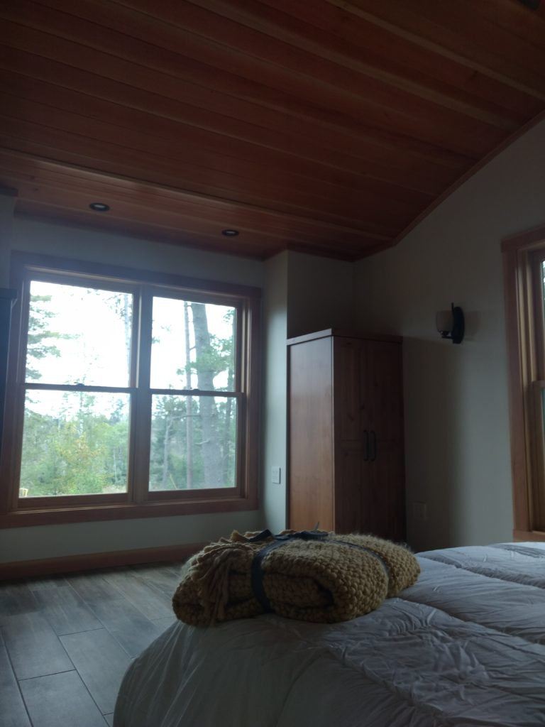 Bedroom with curved douglas fir ceiling