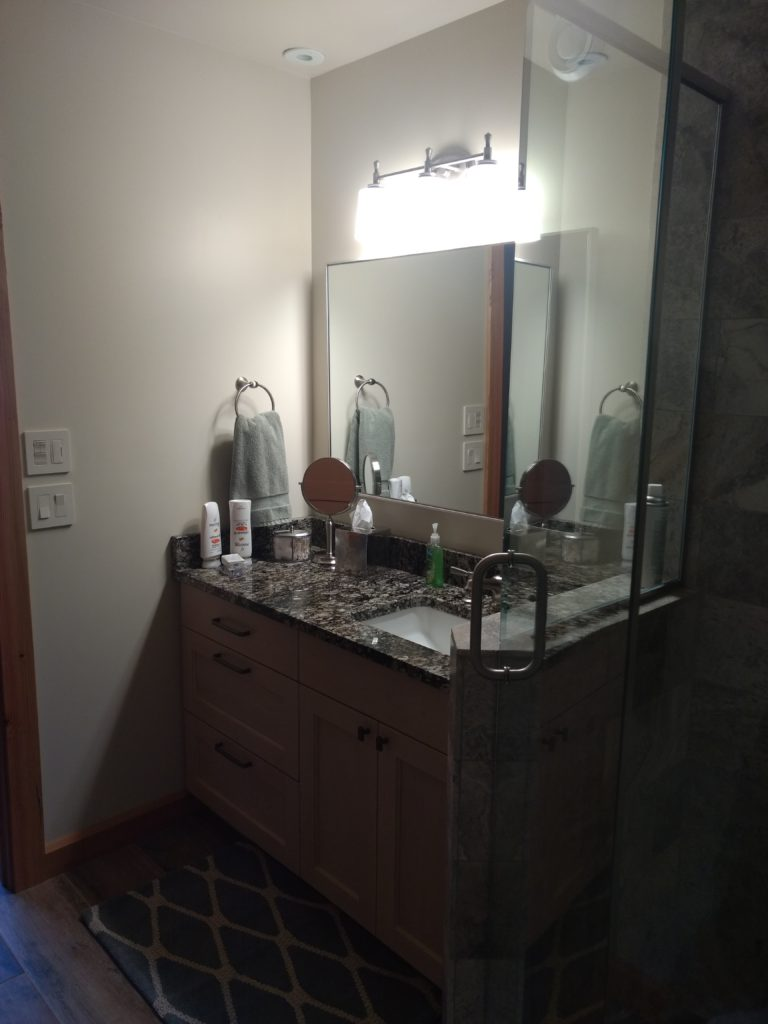 Glass, tile and granite bathroom
