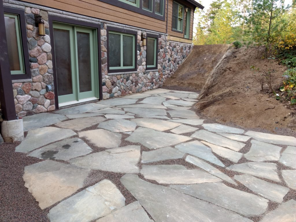 exterior stone on lakeside walkout