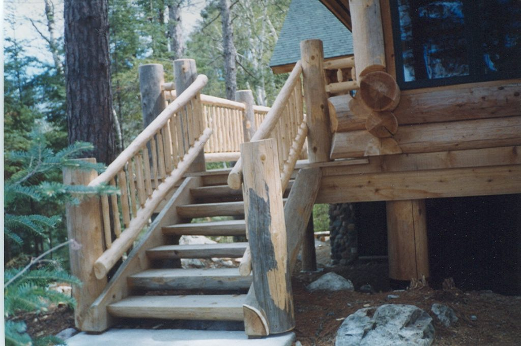 Lakeside deck stairs, log home