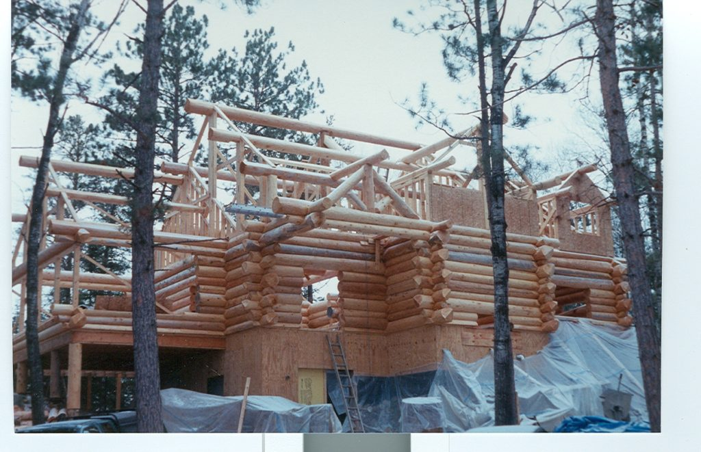 Log construction, log roof system