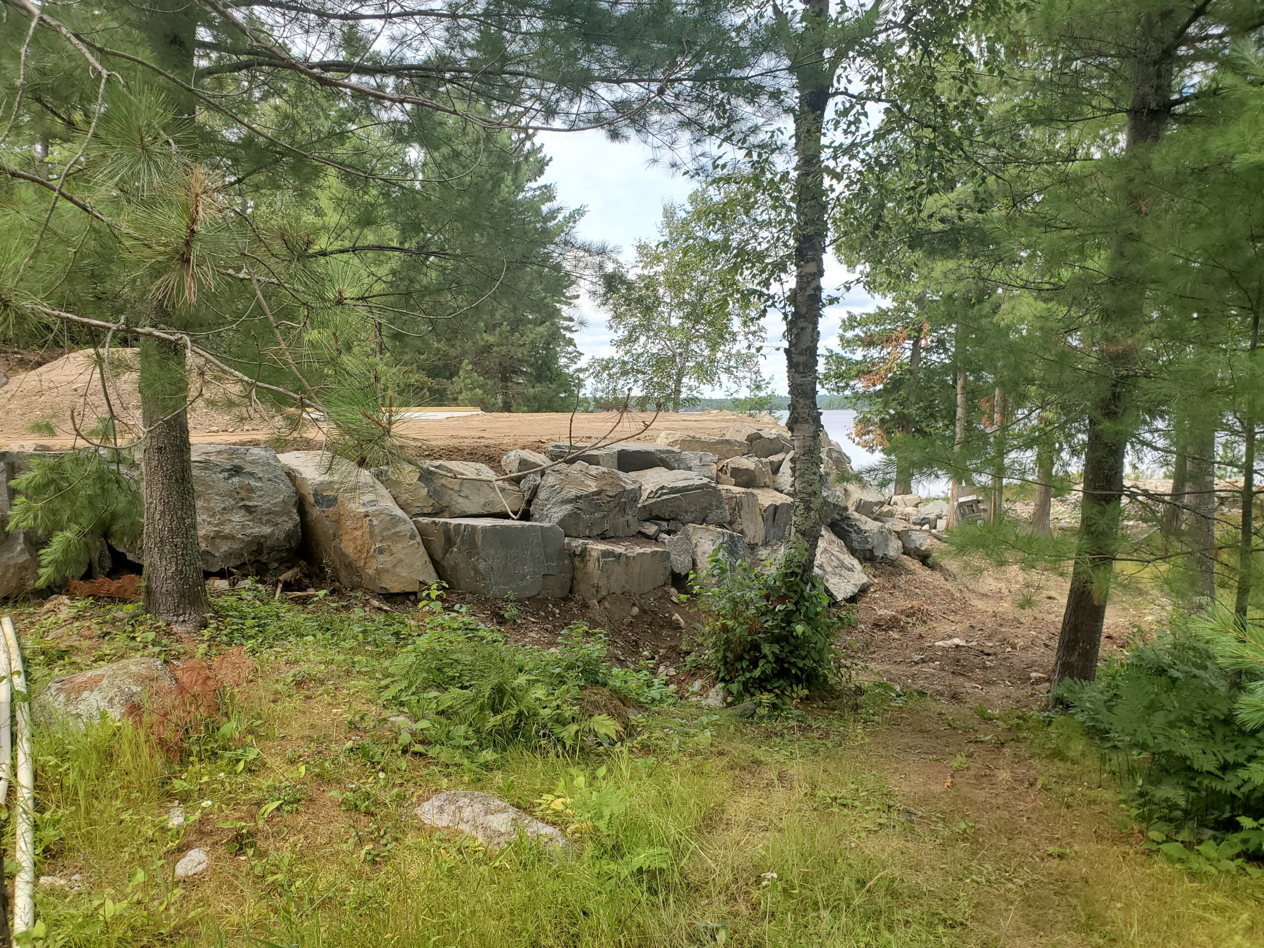 Retaining wall boulders, custom home by Huisman Concepts, Ely MN