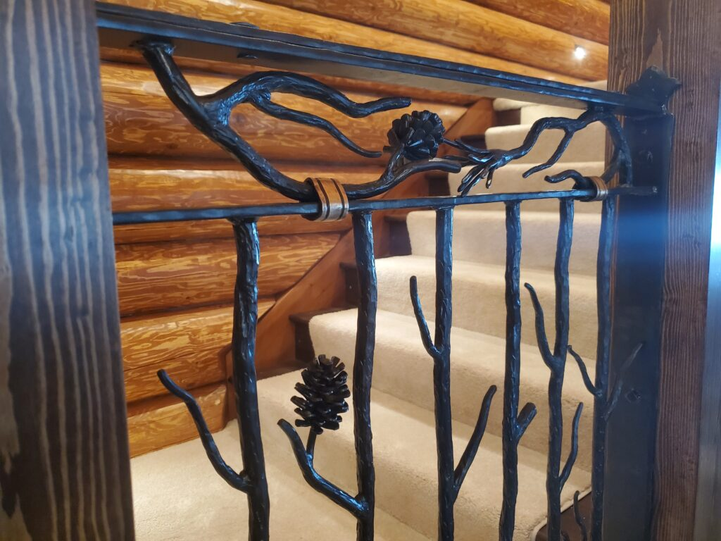Custom iron railing built by Van Madrone Metalworks for a lake home built by Huisman Concepts