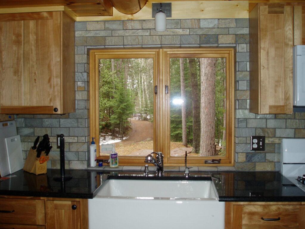 New kitchen remodel, ston backsplas and farm sink