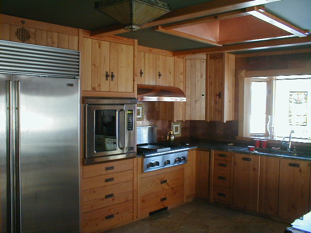 Custom built Doug fir kitchen cabinets and granite counter tops