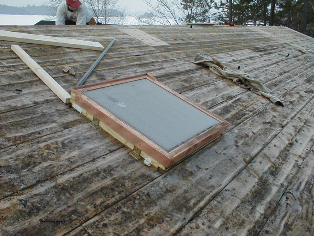 Old plank roof decking and new skylight