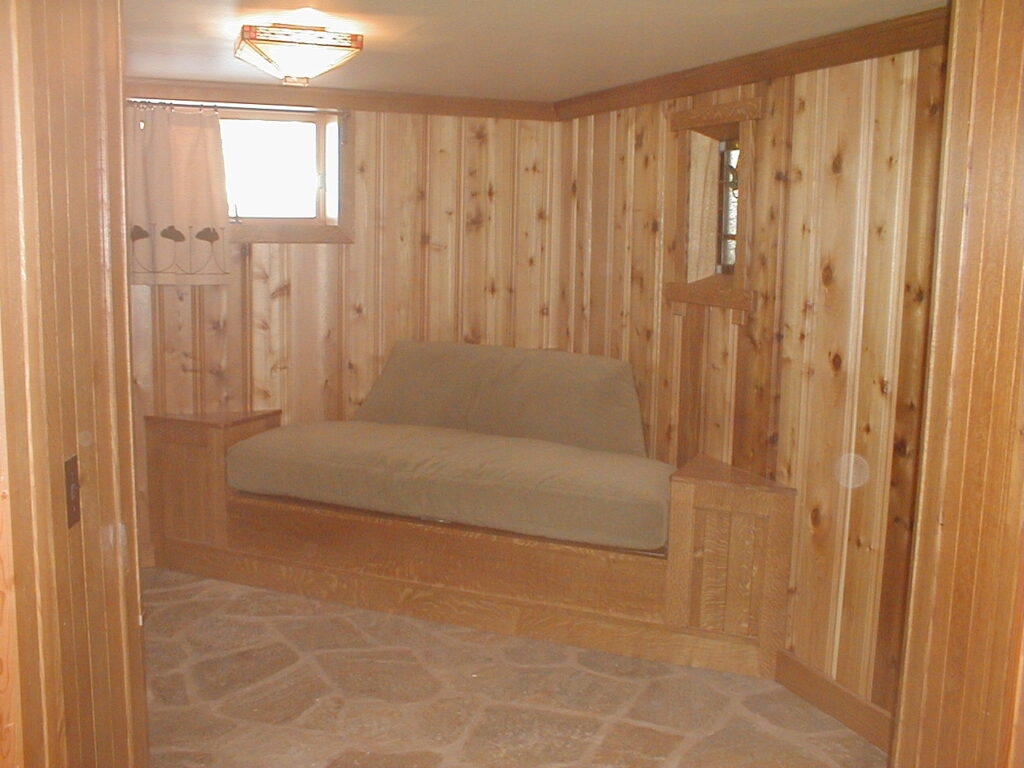 Custom milled cedar paneling and stone floor and built-in custom seating