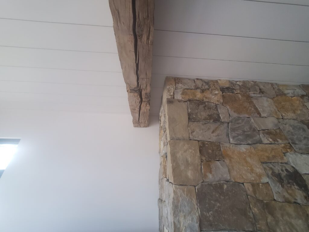 Reclaimed beam and stone work