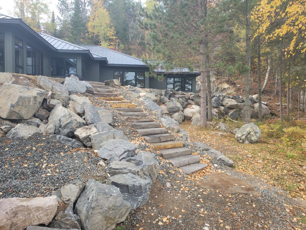 Stone steps up to ely lake home from lake