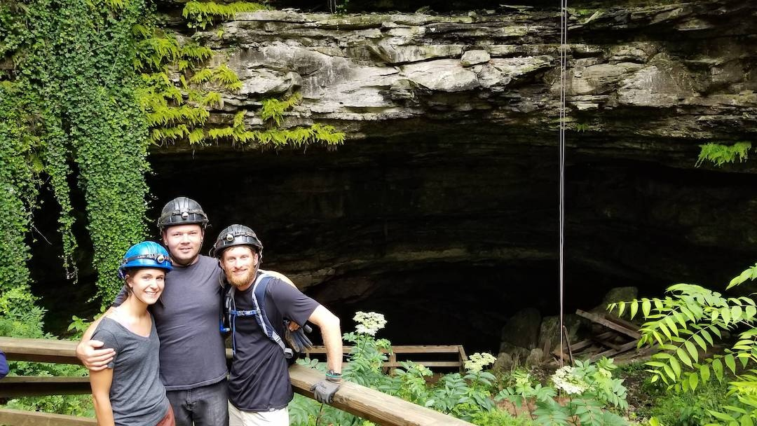 Woman and Two men in front of horse cave kentucky