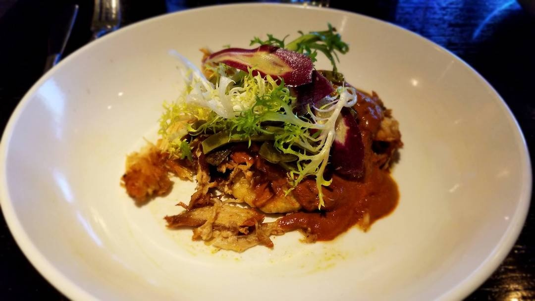 Rabbit in red mole sauce at Mayan Cafe