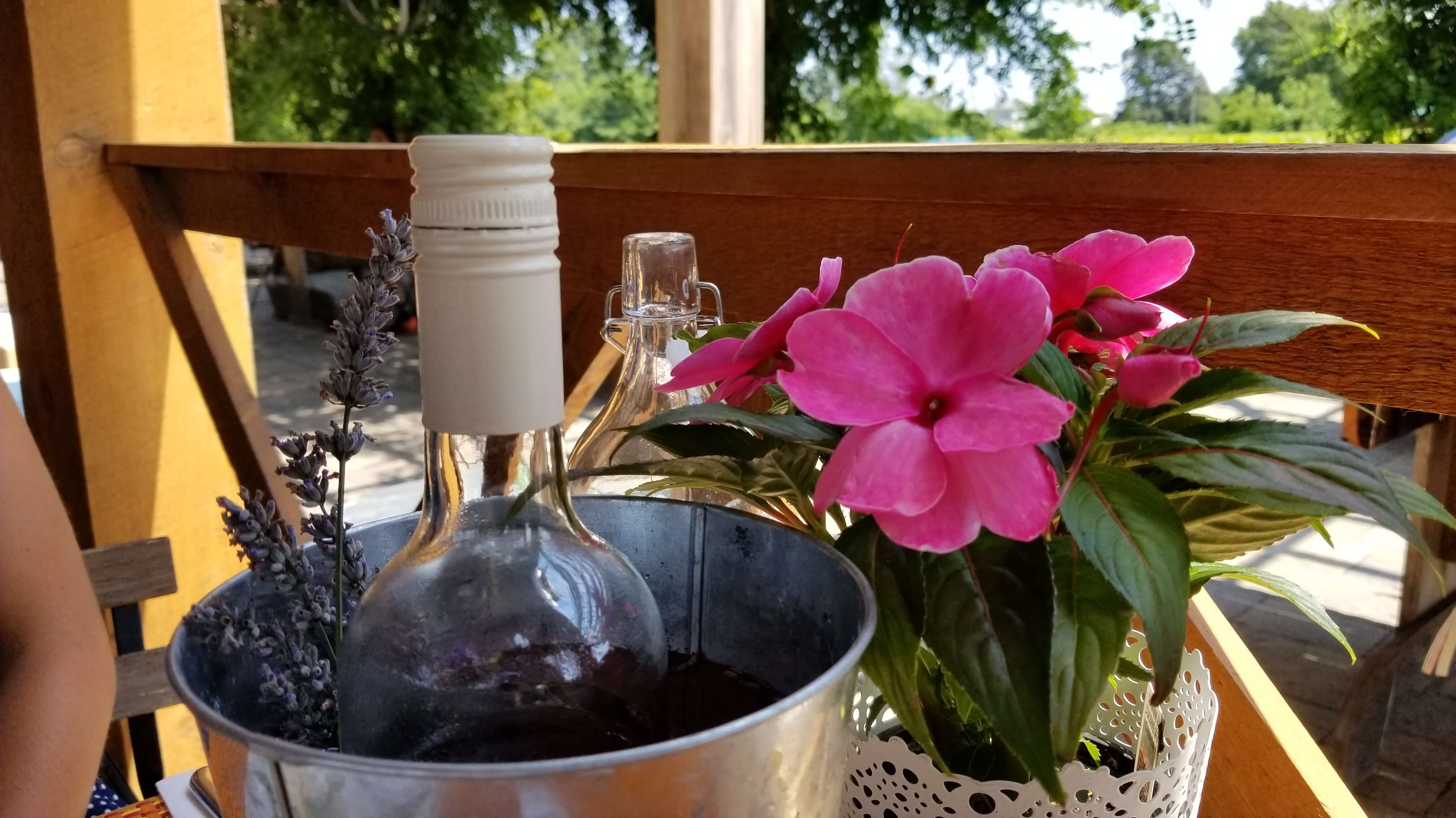 Wine bucket with flowers on table