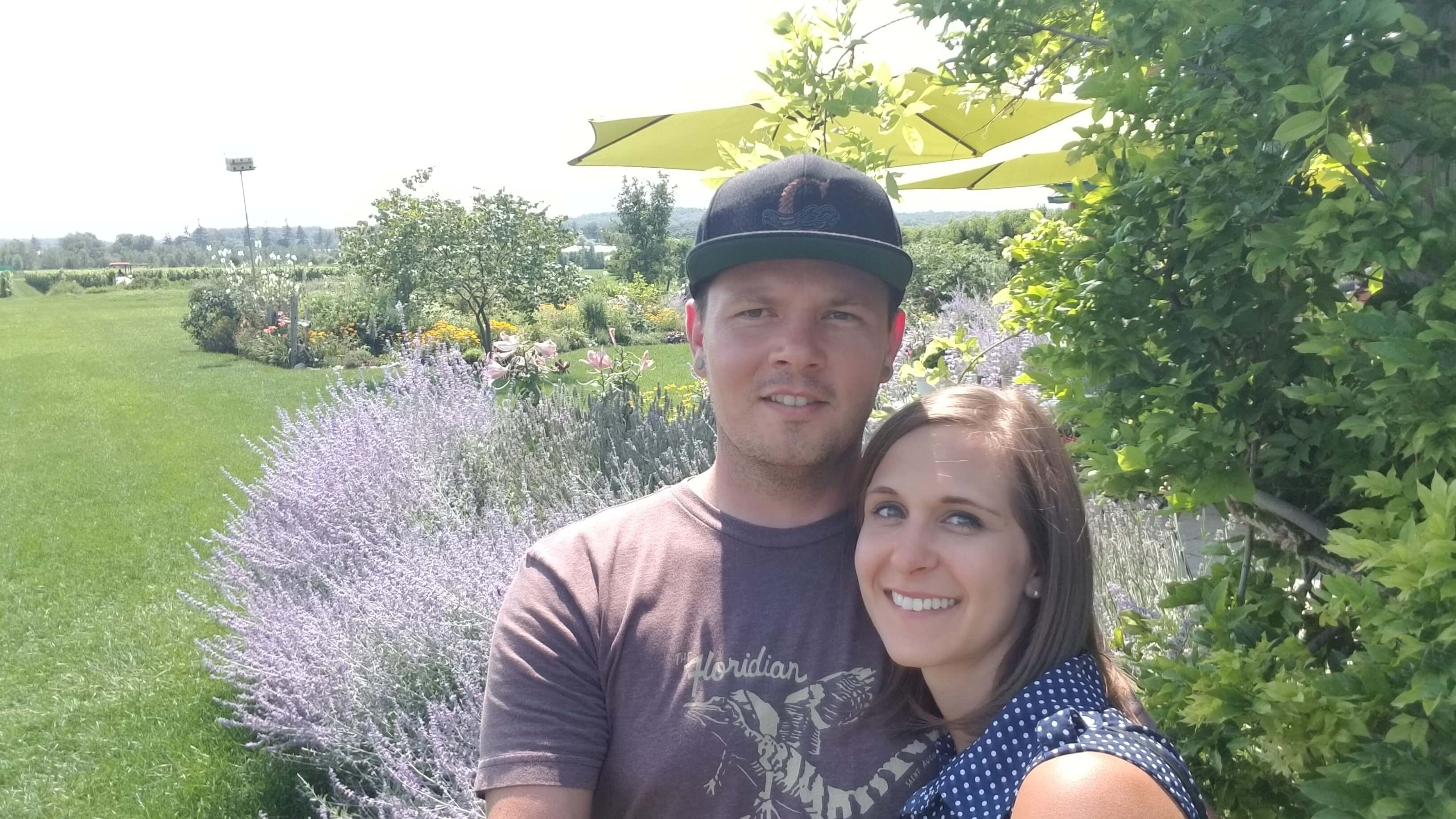 Man and Woman standing next to fresh lavender