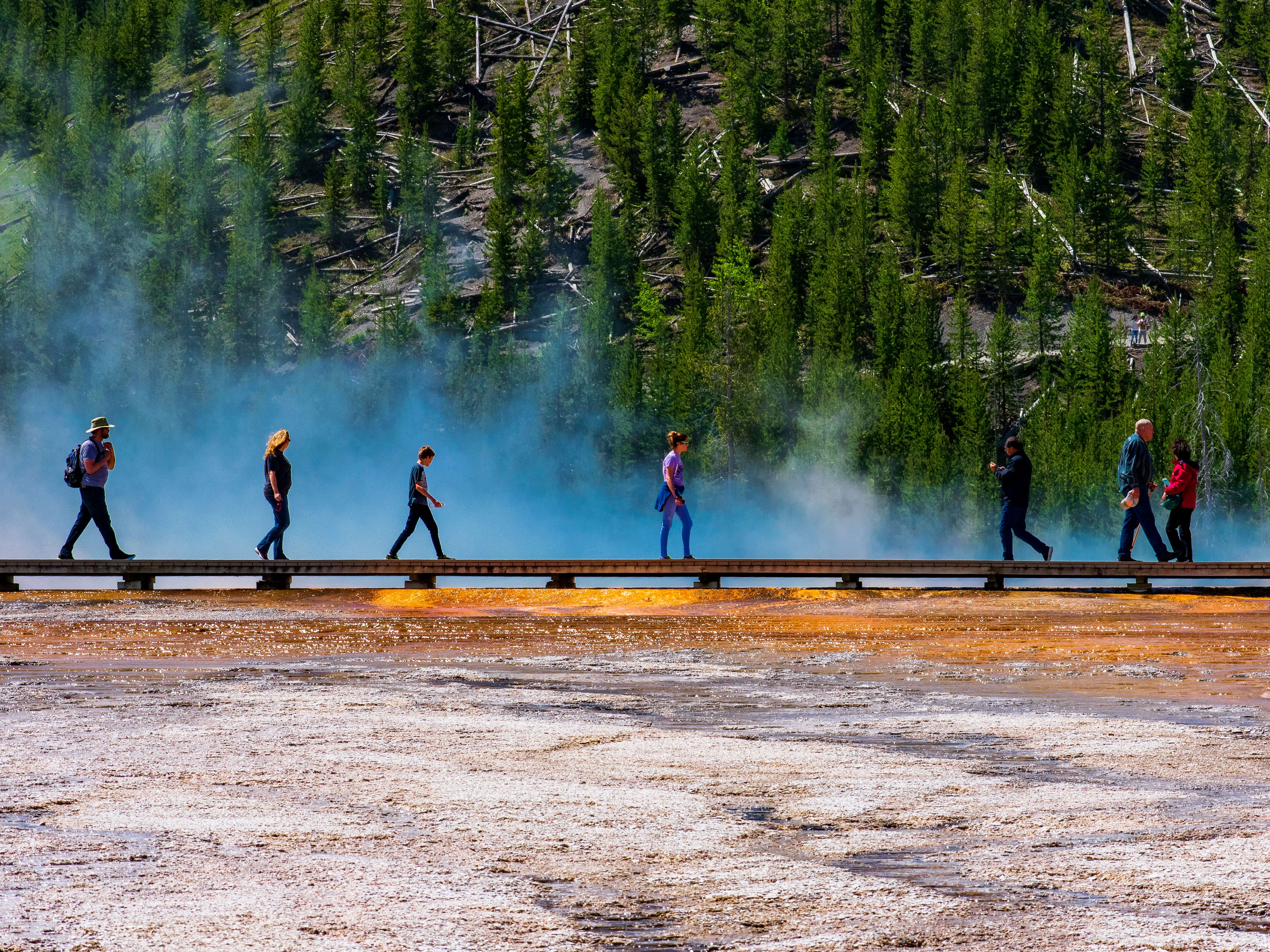 People walking on boardwalk of Grand Prismatic Spring