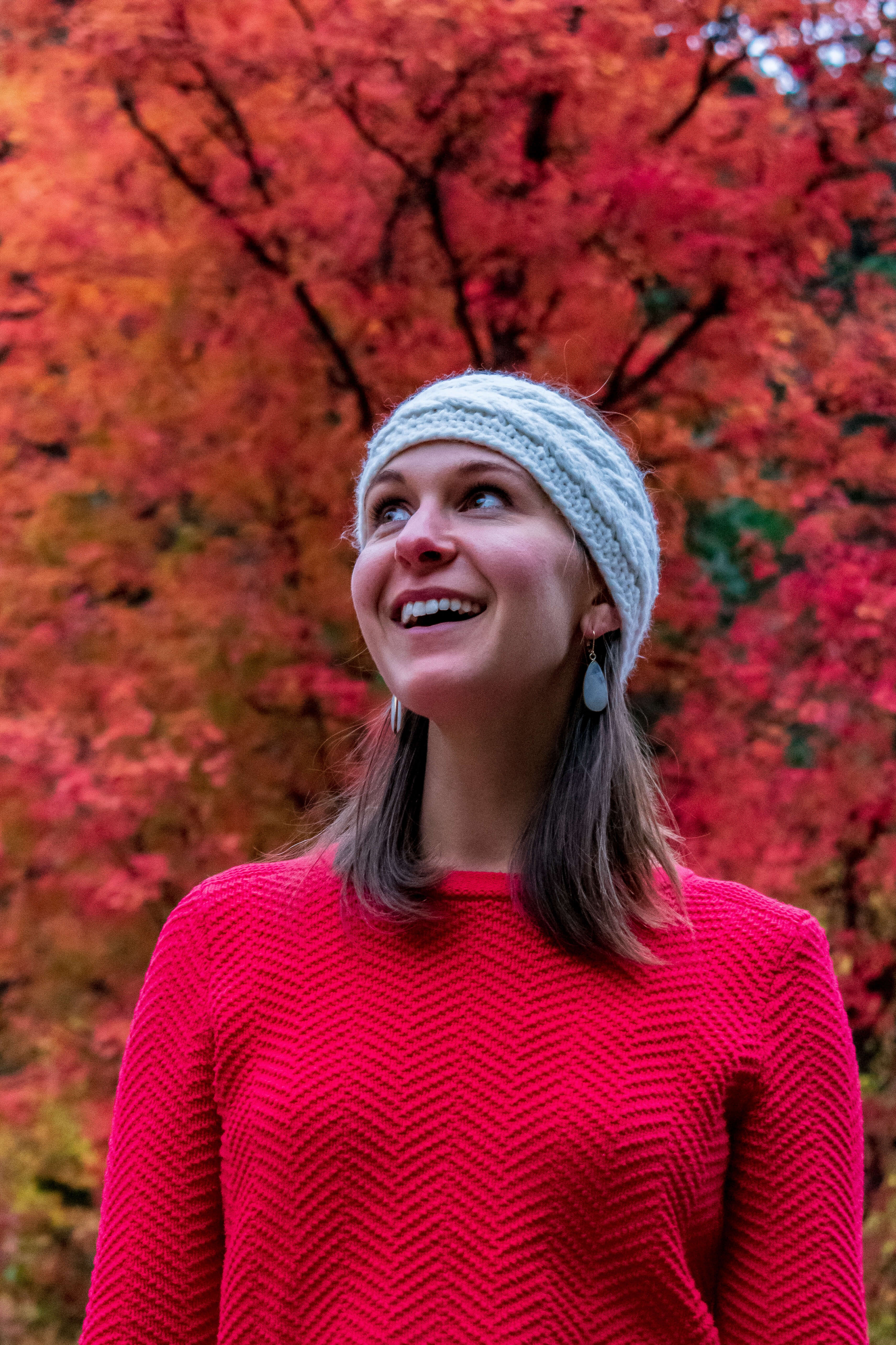 Liz Brumer Smith in front of red tree fall in Utah