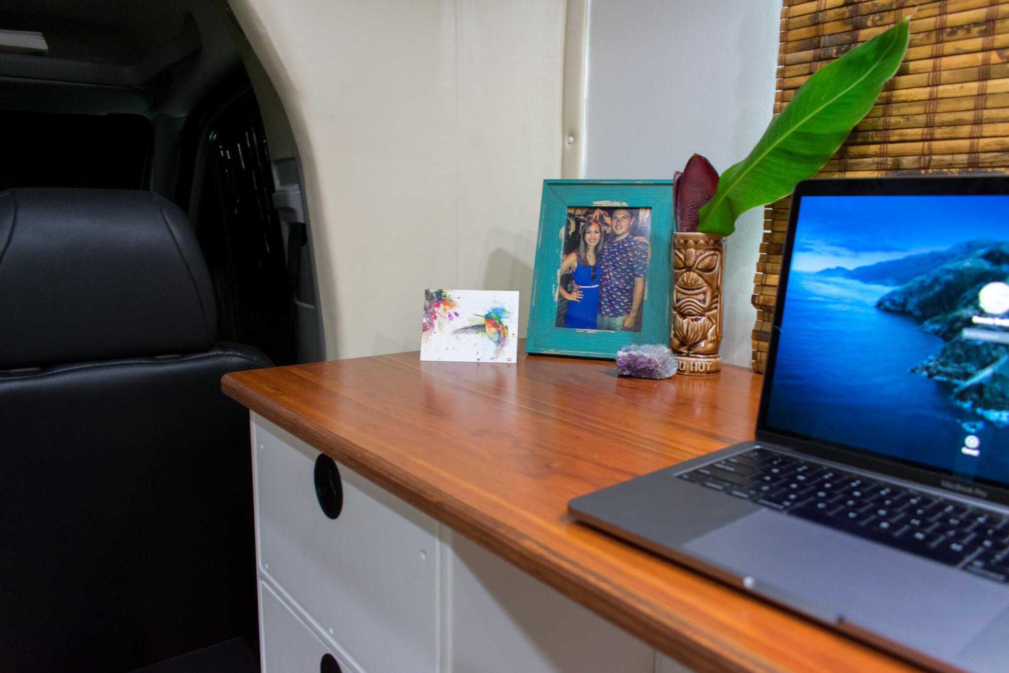 Custom RV desk with tiki mug laptop and picture frame