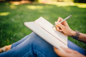 Woman journaling in nature