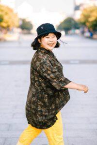Happy woman crossing street
