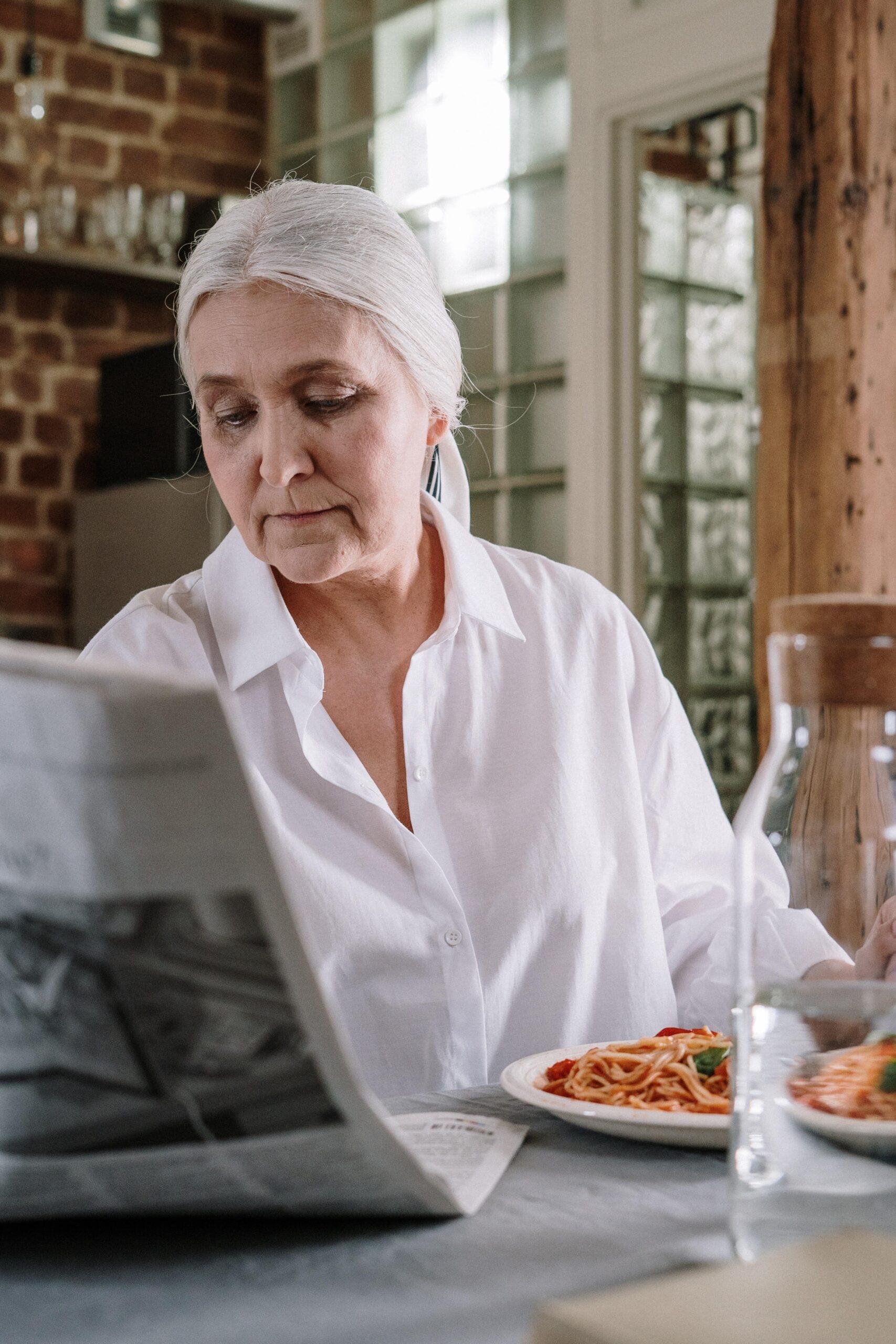Woman Reading Newspaper