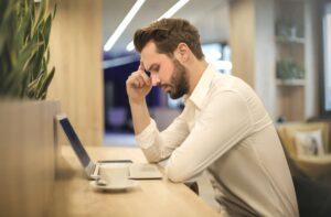 Anxious man at laptop