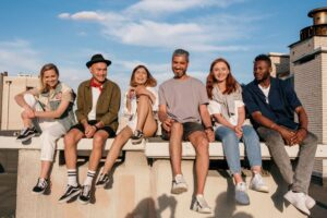Group of friends sitting on wall