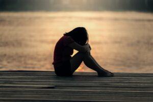 Unhappy woman on pier