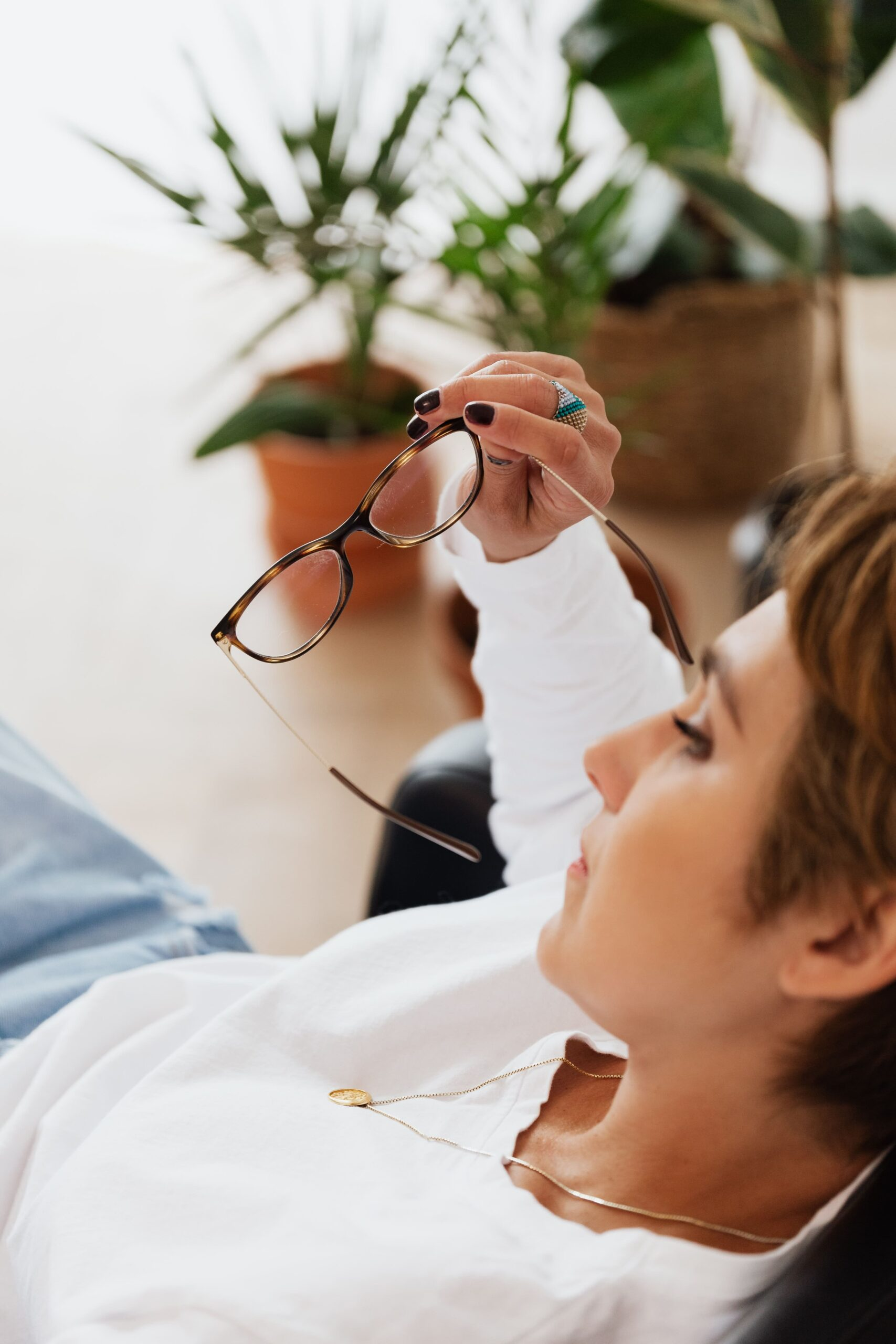 Worried woman reclining with glasses