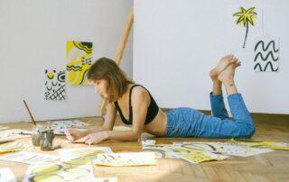 Woman painting on floor